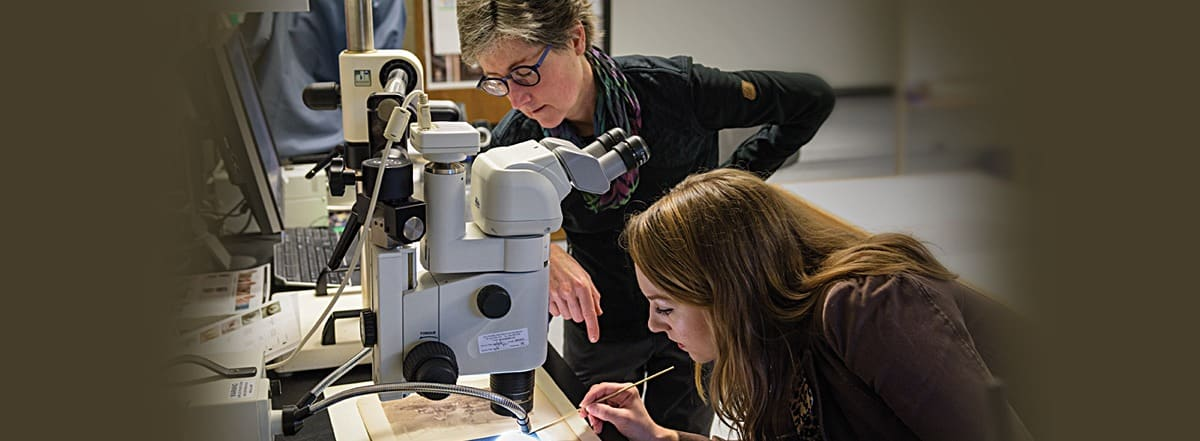 Associate Prof. Julie McGee (left), an expert curator, helps students look for the  hidden gems in collections that offer few clues.