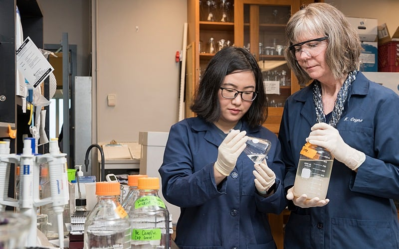 Kathryn Coyne (right) and doctoral student Yanfei Wang
